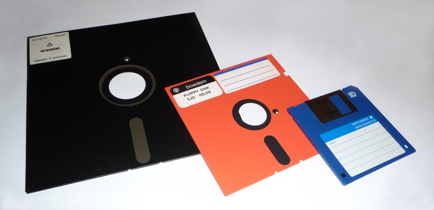 "Floppy disks: (from left) 8in; 5-1/4""; 3-1/2"". The standard data storage format for microcomputers in the 1980s."