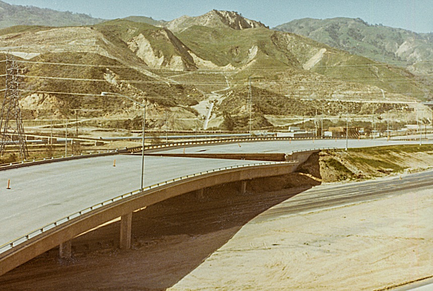 Overpass on the I-5 / Hiway 14 interchange showing separation and subsiding of the roadway.