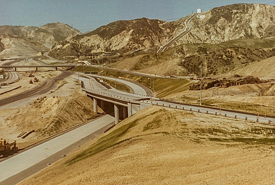 The I-5 / Hiway 14 interchange was still in the final stages of construction when the earthquake hit. This image is deceptive as most of the damage was at the top of the frame. However the roadway that leads in from the lower right is split just after the overpass (detail in another image).